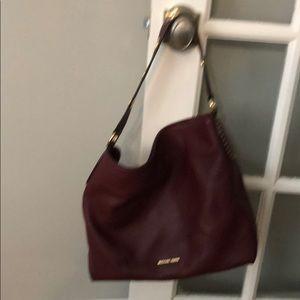 Michael Kors wine colored hand bag - like new